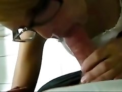 gal with glasses blows and guzzles piss from cock