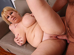 Horny BBW on the couch unzips him, blows him, and lets him into her sexy pussy for fun