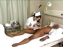 Asian nurses drain black lollipop