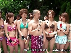 Femmes in bathing suits are partying in the swimming pool - AviDolz