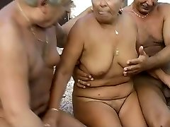 Time worn granny is getting finger fucked in filthy MMF 3some