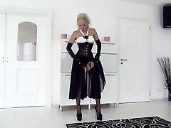 Smoking blonde in corset + heels