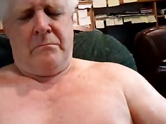 DADDY GETS SUCKED OFF IN HIS READING CHAIR