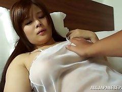 Japanese AV Model is a hot cougar in transparent lingerie