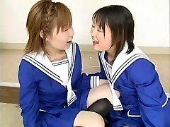 Two Japanese schoolgirls blow multiple dudes and swap jism
