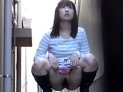 Hairy asian urinates street
