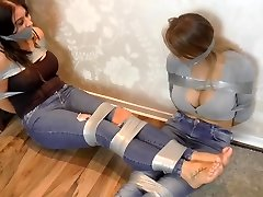 two big breast girls roped up with ductape