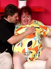 Experienced fatty Margaret parts her huge fat thighs wide to take a cock deep into her snatch