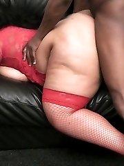 Black BBW beauty in red nylon enjoys thick black cock of a random stranger