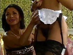Mature lady and her dark-hued maid doing a stud - vintage