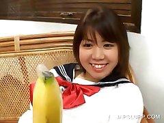 Teen cutie fucking her quim with a banana