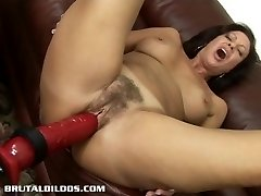 Brunette cougar is screwed hard by a brutal dildo machine