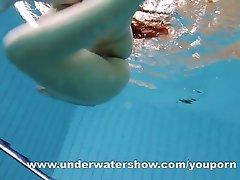 Brunette Kristy stripping underwater