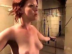 Redhead is chained, whipped, and pin