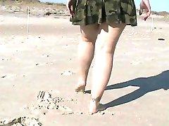 Flashing pussy at a public beach
