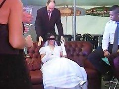 Bride in wedding dress gets a gangbang.