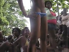 slim ebony jamaican chick bares it all on stage and the ppl go wild