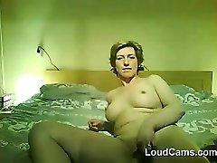 Mature Woman Does A Striptease