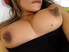 She thumbs her pussy and sucks her lengthy nipples
