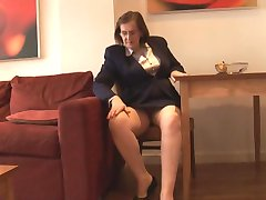 Busty mature secretary with hairy pussy stripping