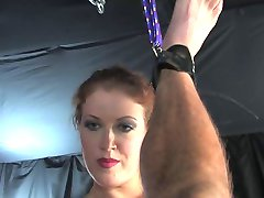 Tall redhead mistress strapon