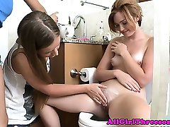 Young lesbos fingering pussy as they fuck threeway