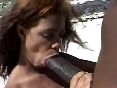 Hefty brown nipples &Ginormous brown cock on the beach.