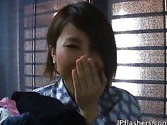 Pretty Asian chick flashing