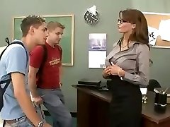 Busty brunette teacher fucks and sucks her two students in threesome