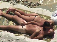 Woman in thong bikini initiates beach sex