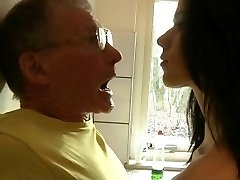 Daring young brunette fucks hard granddad in the kitchen
