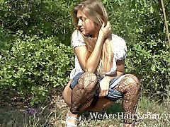 Unshaved woman Riana S loves her walk outside