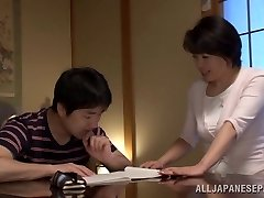 Chiaki Takeshita titillating mature Asian babe in posture 69