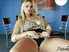 Seductive Abby Brooks getting raw and naughty on a chair by herself