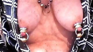 Mature Shakes Heavily jeweled tits