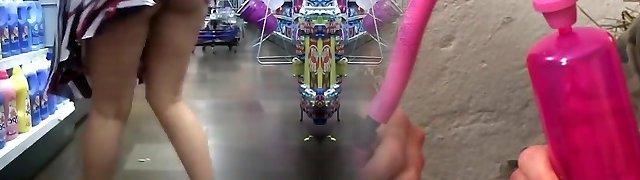 Exhibitionist chick in flip flops demonstrating in supermarket
