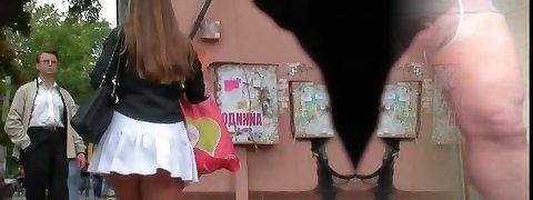 Voyeur movie of a woman in high heels and milky skirt