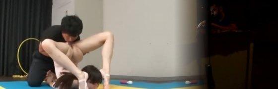 Asian gymnast gargles coachs shaft while instructing