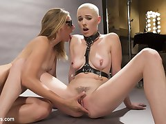 Gorgeous babe Riley Nixon moves to the big city to become a famous fashion model. Pervy photographer, Mona Wales, uses sadistic techniques to motivate her muse! Their photo session includes spanking, caning, bondage, finger banging, pussy licking, face sitting on a queening box, pussy and anal strap-on fucking, and squirting orgasms!!!