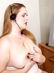 Busty blonde BBW goes online and shows off in the camera by titty fucking a huge dildo