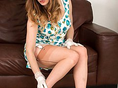 Racy Samantha posing in black seamed ff nylons, white lingerie and peep toe heels.