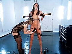 Episode 3: Young and naive, Hanna Reilly is ready for more electrosex. Goddess Aiden Starr has given this pice of fresh meat a soft introduction, and a moderate followup with the motivation of licking and pleasing the Goddesses pussy and ass. This time around Hanna is going to experience the more challenging side of electrosex. Made to stand tall on her tip-toes with the only thing keeping her from falling is a wired hot copper pipe between her legs ready to shock her tender fresh pussy lips. Coupled with a copper pipe hooked behind her elbows keeping her arms restrained high and back. Life would be too easy for Hanna if Goddess Aiden left her at that. No, no, no Aiden pulls out the violet wand to break her muscles down so she falls to her heals and give us all what we want A SHOCKED PUSSY!