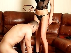 Submissive muscleman earns his mistresss mercy by giving her smooth holes a good skillful licking