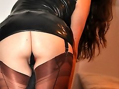 Strapon Jane slips in to a sultry pair of nylon stockings and a bit of leather to go with her...
