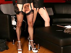 Hot dominatrix Anastasia Pierce trains her male partner to be a good slave with a cane