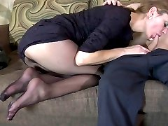 Voluptuous chick making a cock rock-hard with her feet in smooth pantyhose