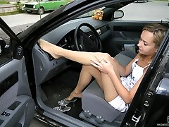Awesome babe prefers driving car with her feet in reinforced toes pantyhose