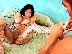 Brunette sucks her own toes while getting her pussy pounded through her fishnets