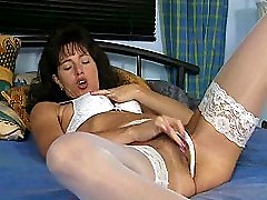 Nasty wife in stockings dildoing very hairy pussy in the bedroom