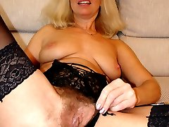 Older slut with massive bush loves to fuck!